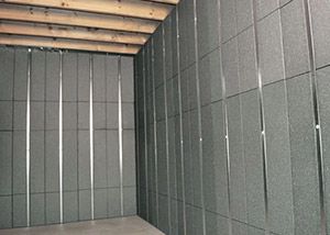 SilverGlo™ insulation and metal studs making up our Basement to Beautiful™ panels.  Installed in St. Paul.