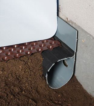 Closeup of a crawl space drainage system installed in Gilbert