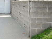 A retaining wall separating from the adjoining walls in Aitkin