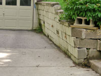a failing retaining wall around a driveway in Duluth