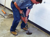 Coring the concrete of a concrete slab floor in Eveleth