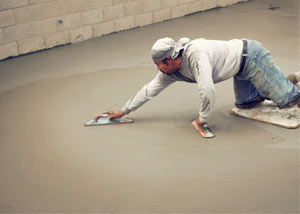 smoothing out the grout in a slab releveling project in St. Paul