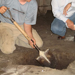 Digging a hole for the engineered fill used in a crawl space support system installation in St. Paul