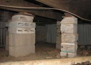 crawl space repairs done with concrete cinder blocks and wood shims in a Bemidji home