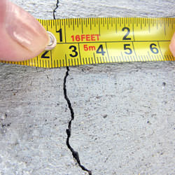 A crack in a poured concrete wall that's showing a normal crack during curing in Mooselake