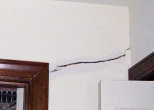 A large drywall crack in an interior wall in Hermantown