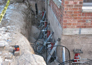 Foundation push piers installed around a house with a foundation settlement issues in Gilbert