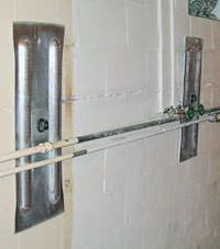A foundation wall anchor system used to repair a basement wall in Ely