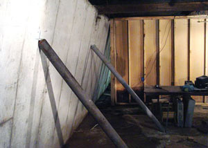 A severely tilting foundation wall propped up by steel beams in Aitkin.