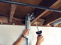 Straightening a foundation wall with the PowerBrace™ i-beam system in a Ashland home.